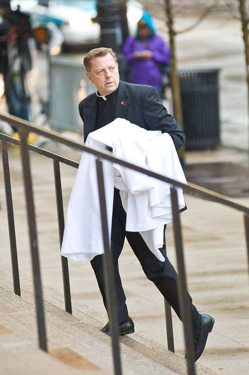 . CHICAGO, IL - APRIL 08:  Father Michael Pfleger attends funeral services for Roger Ebert at Holy Name Cathedral on April 8, 2013 in Chicago, Illinois.  (Photo by Timothy Hiatt/Getty Images)