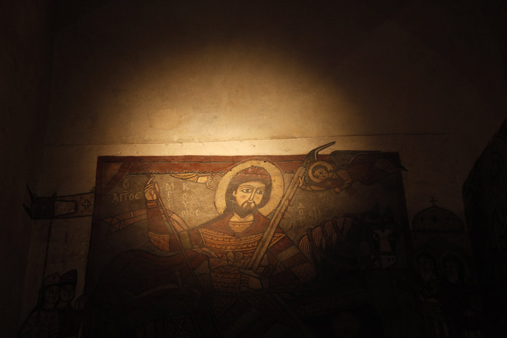 . Frescos dating back to the thirteenth century at the ancient monastery of St. Anthony southeast of Cairo, Egypt on Tuesday, April 16, 2013. In a cave high in the desert mountains of eastern Egypt, the man said to be the father of monasticism took refuge from the temptations of the world some 17 centuries ago. The monks at the St. Anthony\'s Monastery bearing his name continue the ascetic tradition. But even they are not untouched by the turbulent times facing Egypt\'s Christians, defiantly vowing their community\'s voice won\'t be silenced amid Islamists\' rising power.   (AP Photo/Manoocher Deghati)