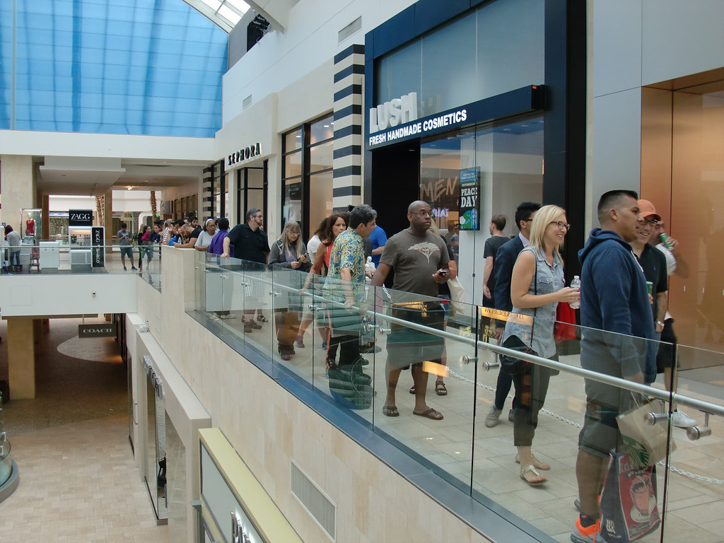 . Most of the stores -- excepting the Apple Store -- weren\'t open at 9:30 a.m. Friday, Sept. 20, 2013, as customers queued for the new iPhone 5c and 5s at Westfield Topanga. (Photo by Steven Rosenberg/Los Angeles Daily News)