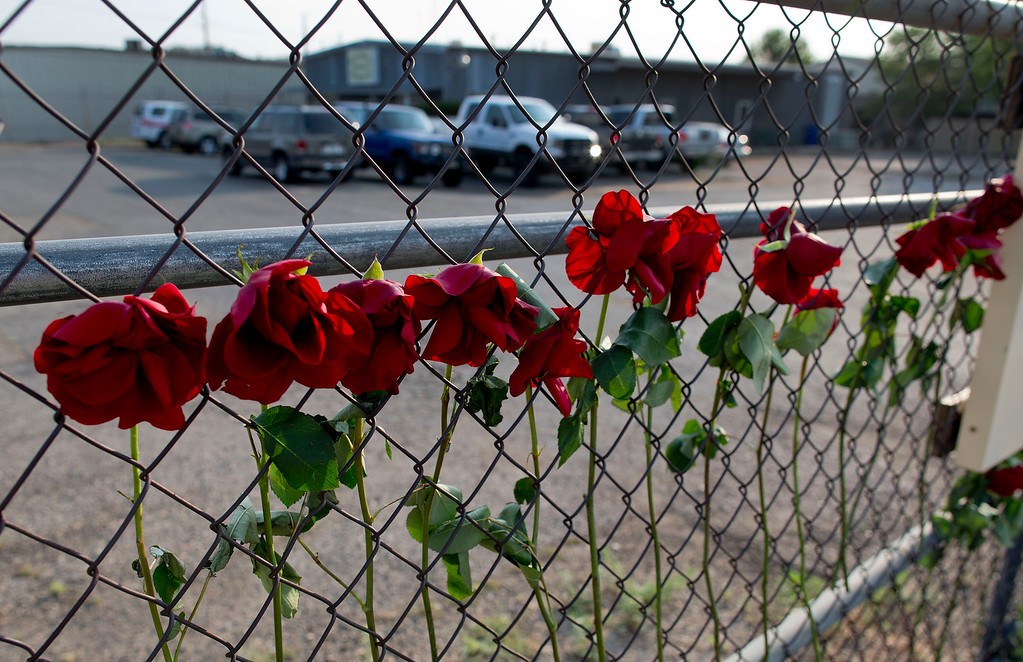 . Flowers hang on the fence outside the Granite Mountain Hot Shot Crew fire station, Monday, July 1, 2013, in Prescott, Ariz. (AP Photo/Julie Jacobson)