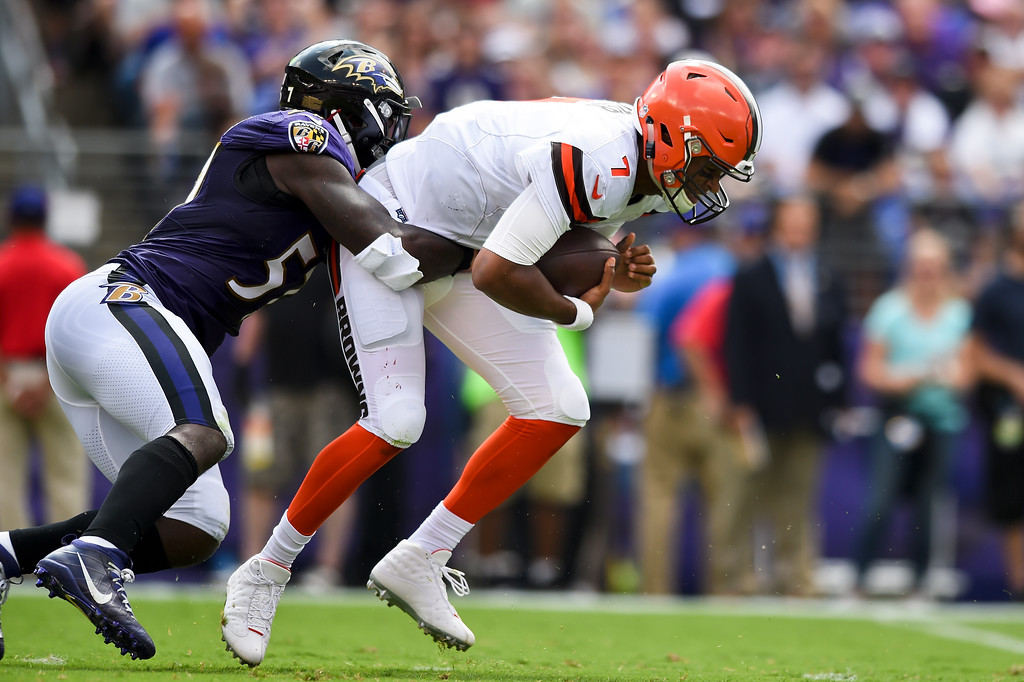 . Cleveland Browns quarterback DeShone Kizer (7) is sacked by Baltimore Ravens inside linebacker C.J. Mosley (57) during the first half of an NFL football game in Baltimore, Sunday, Sept. 17, 2017. (AP Photo/Gail Burton)
