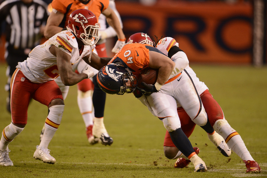 . Denver Broncos running back Jacob Hester (40) gets tackled in the fourth quarter as the Denver Broncos took on the Kansas City Chiefs at Sports Authority Field at Mile High in Denver, Colorado on December 30, 2012. John Leyba, The Denver Post