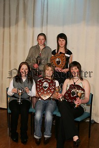 Rathfriland High School award winners. Front from left, Emma Magennis, Attainment Cup, Emma Sterritt, Hamilton Shield for Music and Victoria Herron, Home Economics Shield, McKeever Cup and Weir Cup for Mathematics. Looking on are, Margaret Megaw,(left)  Anne Cromie Cup for Girls Sport and Emma McMinn, The Art and Design Shield. 48-28-06.