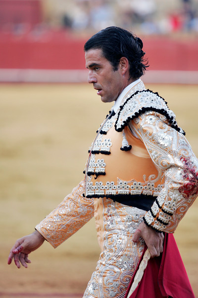 Blood stains on Uceda Leal's traje de luces (bullfighter's dress). Bullfight at Real Maestranza bullring, Seville, Spain, 15 August 2006.