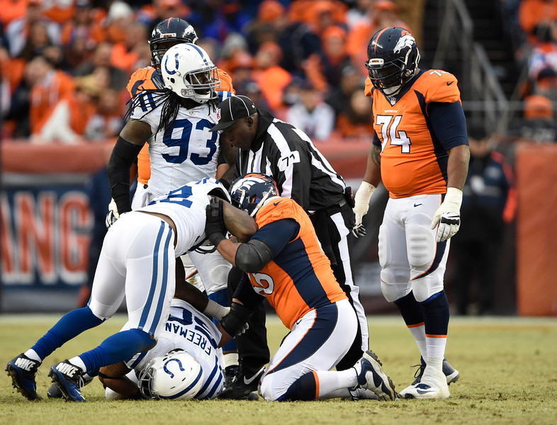 . Jerrell Freeman (50) of the Indianapolis Colts recovers a fumble. The Denver Broncos played the Indianapolis Colts in an AFC divisional playoff game at Sports Authority Field at Mile High in Denver on January 11, 2015. (Photo by Joe Amon/The Denver Post)
