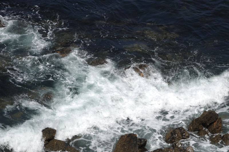 Ocean waves and a rocky shore, as seen from a Palos Verdes cliff.