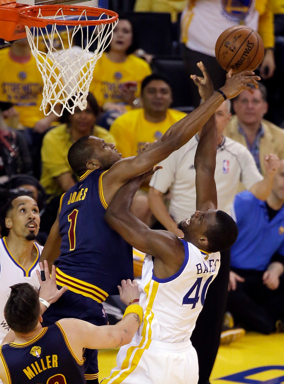 . Cleveland Cavaliers forward James Jones (1) defends a shot by Golden State Warriors forward Harrison Barnes (40) during the first half of Game 5 of basketball\'s NBA Finals in Oakland, Calif., Sunday, June 14, 2015. (AP Photo/Eric Risberg)