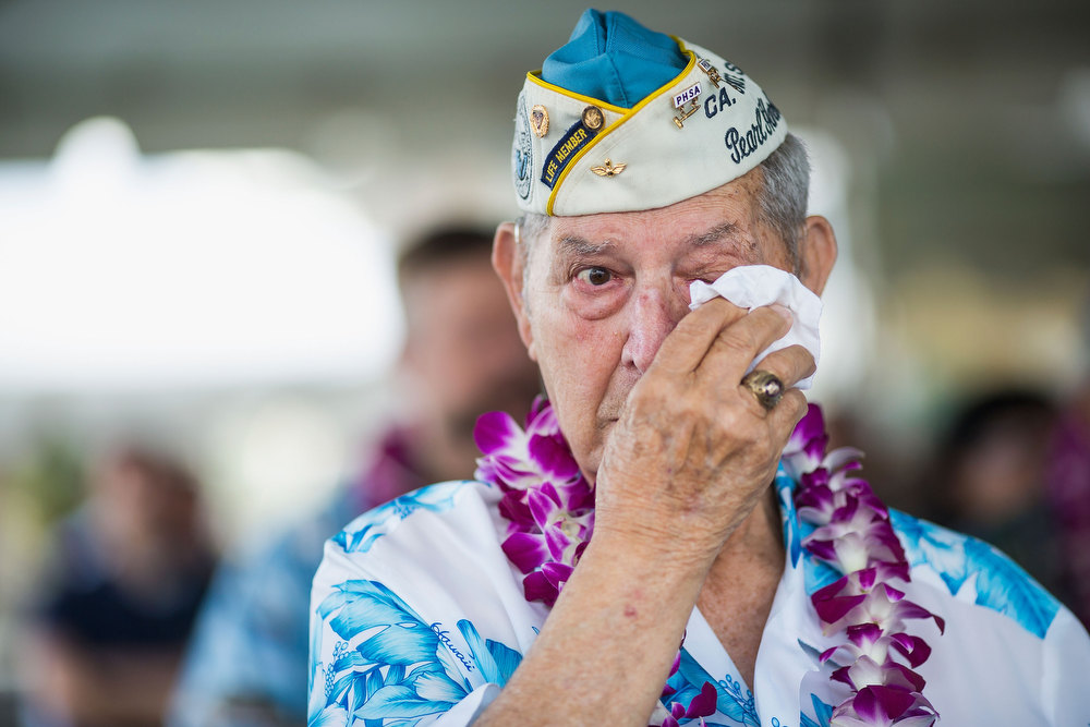 Description of . Pearl Harbor survivors Michael Ganitch of California and Robert McCoy of Hawaii talk during the 71st Annual Memorial Ceremony Pearl Harbor survivor Victor Miranda wipes his eyes during the 71st Annual Memorial Ceremony commemorating the WWII Attack On Pearl Harbor at the World War 2 Valor in the Pacific National Monument December 7, 2012 in Pearl Harbor, Hawaii. This is the 71st anniversary of the Japanese attack on pearl Harbor.  (Photo by Kent Nishimura/Getty Images)