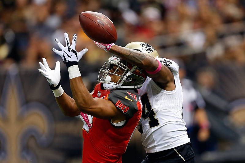 . Corey White #24 of the New Orleans Saints defends a pass intended for Robert Herron #10 of the Tampa Bay Buccaneers during the second quarter of a game at the Mercedes-Benz Superdome on October 5, 2014 in New Orleans, Louisiana.  (Photo by Wesley Hitt/Getty Images)