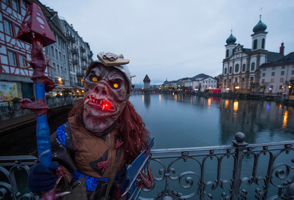 . A carnival participant in costume poses in the historic center of Lucerne, Switzerland, 27 February 2014.  EPA/SIGI TISCHLER