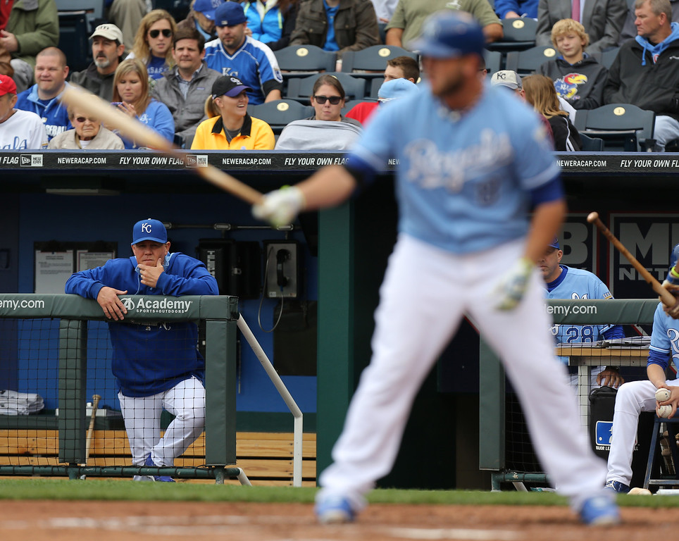 . KANSAS CITY, MO - MAY 14:  Manager Ned Yost #3 of the Kansas City Royals watches Mike Moustakas #8 of the Kansas City Royals bat in the second inning against the Colorado Rockies at Kauffman Stadium on May 14, 2014 in Kansas City, Missouri. (Photo by Ed Zurga/Getty Images)