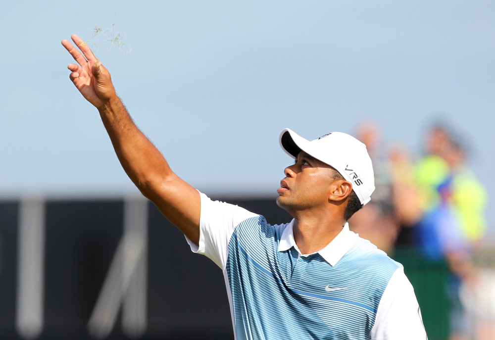 . US golfer Tiger Woods tests the wind on the 4th tee during his first round on the opening day of the 2014 British Open Golf Championship at Royal Liverpool Golf Course in Hoylake, north west England on July 17, 2014. A rusty Tiger Woods made a poor start to the British Open at Royal Liverpool Golf Club on Thursday with bogeys at the first two holes. (PETER MUHLY/AFP/Getty Images)