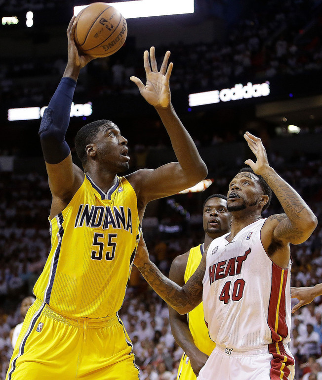 . Indiana Pacers center Roy Hibbert (55) shoots under the defense of Miami Heat power forward Udonis Haslem (40) during the first half of Game 7 in their NBA basketball Eastern Conference finals playoff series, Monday, June 3, 2013 in Miami. (AP Photo/Lynne Sladky)