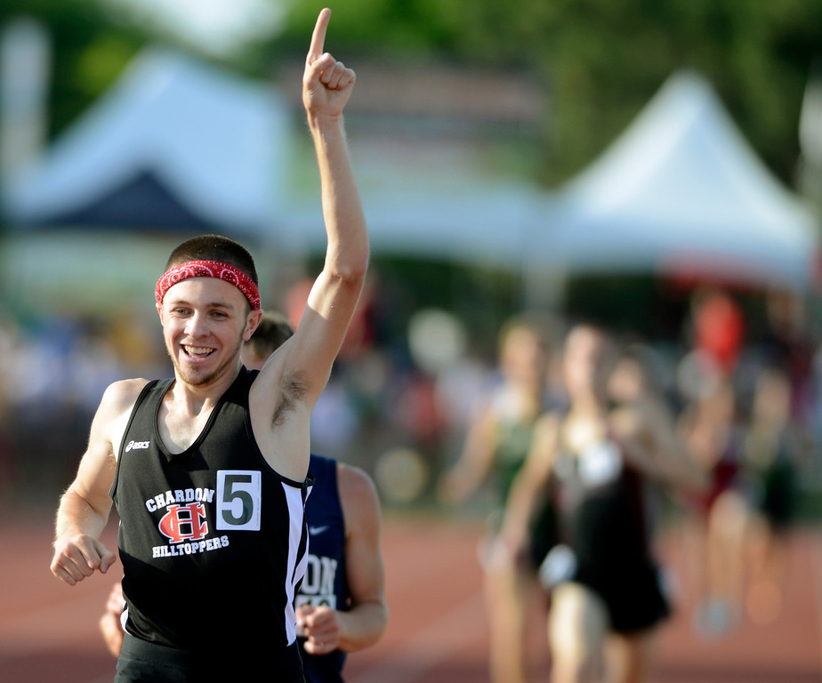 . Maribeth Joeright/MJoeright@News-Herald.com <p> Chardon\'s Nick Elswick celebrates his state championship victory in the boys 3200 meter run during the state track and field championship meet in Columbus,  June 7, 2014.
