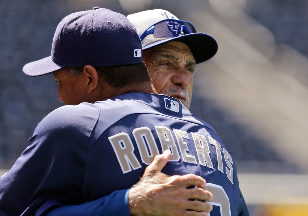 . San Diego Padres coach Dave Roberts, front, and Los Angeles Dodgers coach Davey Lopes greet one another before the Padres\' home-opener baseball game in San Diego, Tuesday, April 9, 2013. (AP Photo/Lenny Ignelzi)