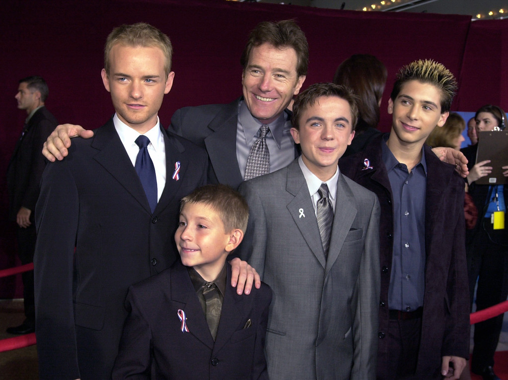 """. Cast members from \""""Malcolm in the Midddle\"""" arrive for the 53rd annual Primetime Emmy Awards at the Shubert Theatre on Sunday, Nov. 4, 2001, in Los Angeles. Shown clockwise from left are: Chris Masterson, Bryan Cranston, Justin Berfield, Frankie Muniz, and Erik Per Sullivan. (AP Photo/Kim D. Johnson)"""