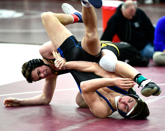 2/16/2019 Mike Orazzi | Staff Bristol Eastern's Noah Piazza and Daniel Hand's Carter Ganino during the CIAC state open wrestling tournament at Bristol Central High School in Bristol Saturday.