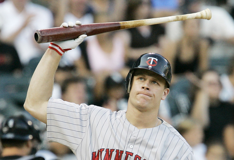 . The Twins\' Justin Morneau throws his bat after striking out during the eighth inning of their game against the Chicago White Sox on Saturday, Sept. 8, 2007, in Chicago. The Sox defeated the Twins 8-7. (AP Photo/M. Spencer Green)