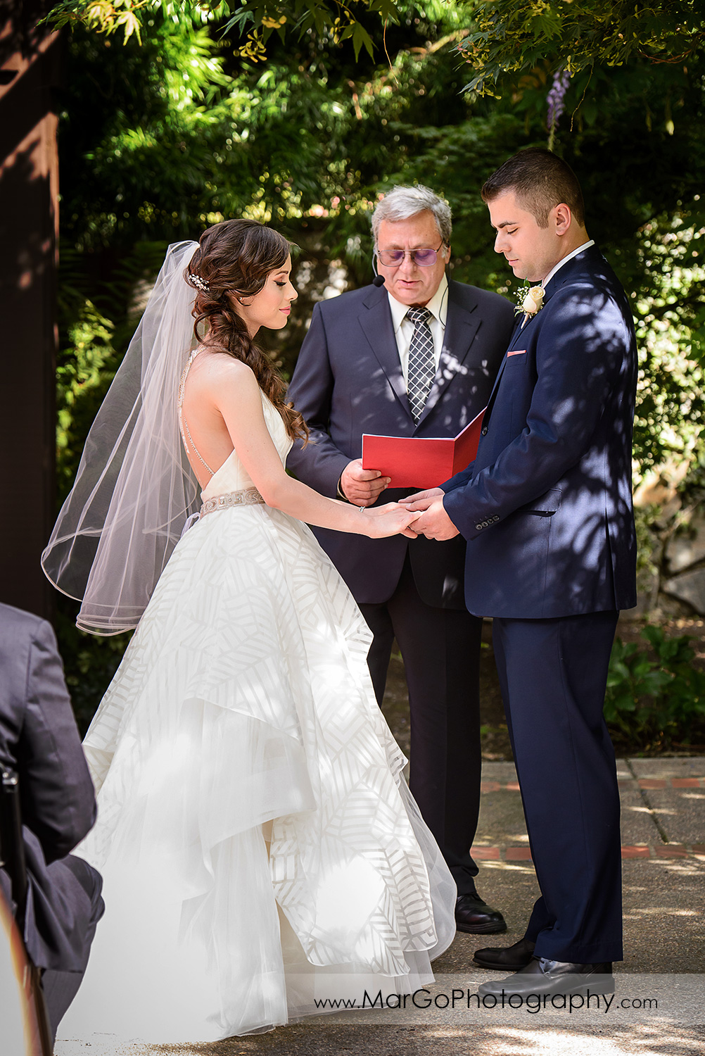 bride and groom holding hands during wedding ceremony at Saratoga Foothill Club