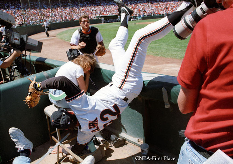 The San Francisco Giants' Will Clark dives into the photographer's well to catch a foul popup by Jeff Conine of the Marlins.  Hayward Daily Review/Dino Vournas