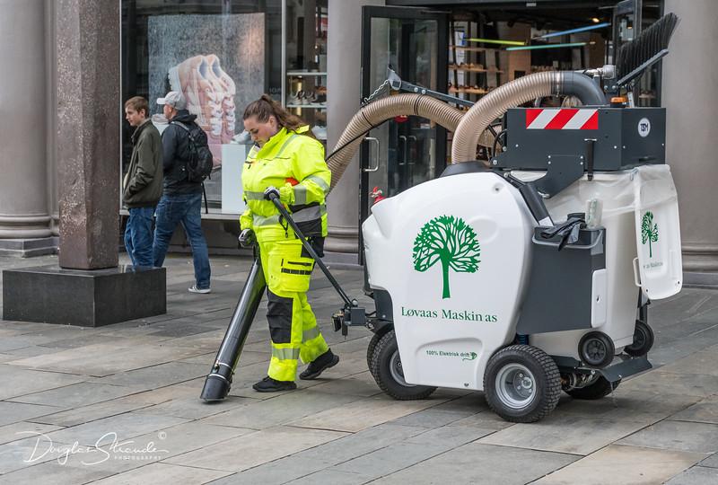 Vacuuming the sidewalk