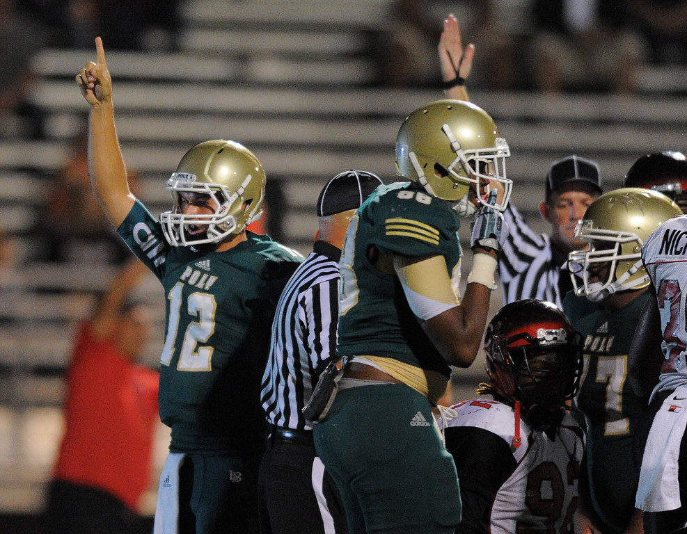 . Long Beach Poly football takes on Centennial (Corona) as part of the Mission Viejo Classic in Mission Viejo, CA on Friday, September 13, 2013. Poly QB Josh Love, left, celebrates his quarterback keeper 2-yard TD in the 2nd qtr. (Photo by Scott Varley, Press-Telegram)
