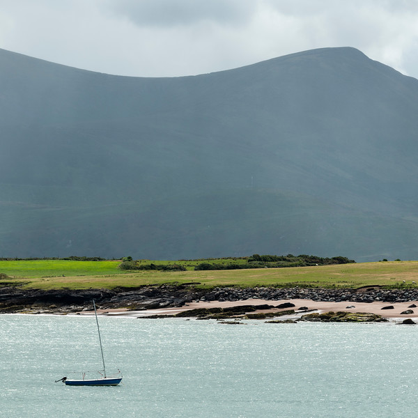 Sailboat in the ocean with mountain in the background, Goulane Ard, Brandon, County Kerry, Ireland