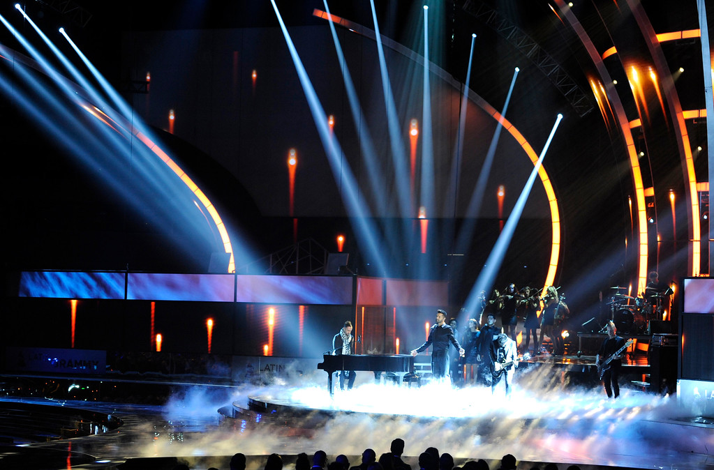 . Mario Domm, of the musical group Camila, left, and Ricky Martin perform on stage at the 15th annual Latin Grammy Awards at the MGM Grand Garden Arena on Thursday, Nov. 20, 2014, in Las Vegas. (Photo by Chris Pizzello/Invision/AP)