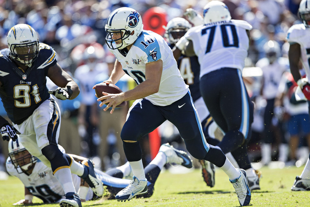 . Jake Locker #10 of the Tennessee Titans runs the ball against the San Diego Chargers at LP Field on September 22, 2013 in Nashville, Tennessee.  The Titans defeated the Chargers 20-17.  (Photo by Wesley Hitt/Getty Images)