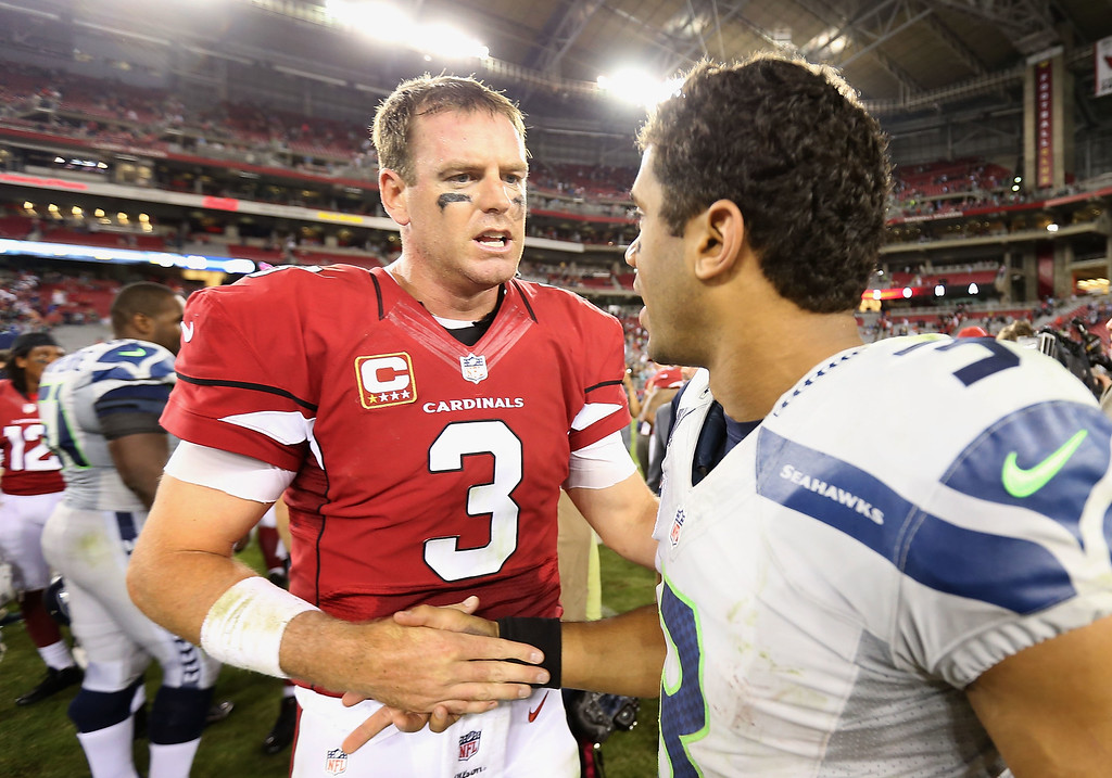 . GLENDALE, AZ - OCTOBER 17:  Quarterbacks Carson Palmer #3 of the Arizona Cardinals and Russell Wilson #3 of the Seattle Seahawks shake hands following the NFL game at the University of Phoenix Stadium on October 17, 2013 in Glendale, Arizona.  The Seahawks  defeated the Cardinals 34-22. (Photo by Christian Petersen/Getty Images)