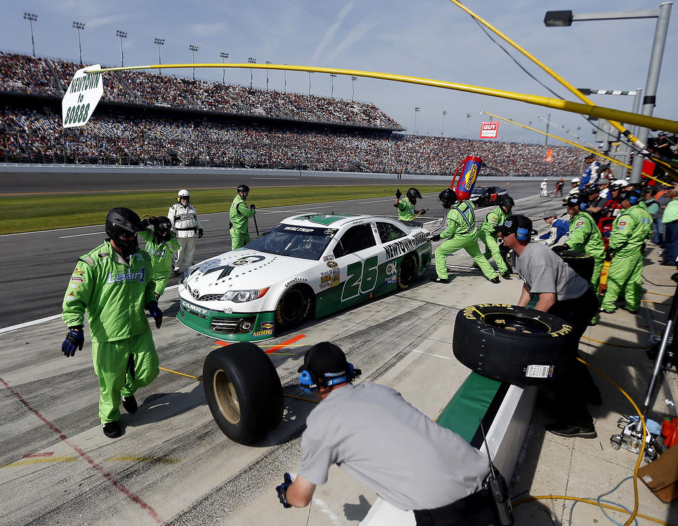 . Michael Waltrip, driver of the #26 Sandy Hook School Support Fund Toyota, pits during the NASCAR Sprint Cup Series Budweiser Duel 1 at Daytona International Speedway on February 21, 2013 in Daytona Beach, Florida.  (Photo by Chris Graythen/Getty Images)