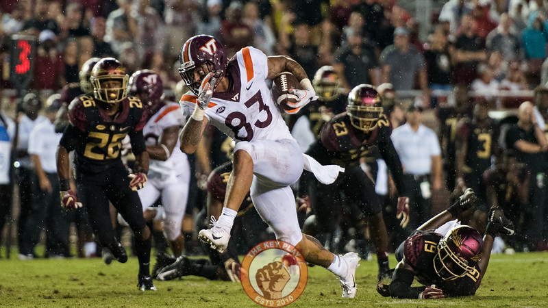 Eric Kumah (83) breaks a tackle en route to scoring the game-sealing touchdown during the matchup between Virginia Tech and Florida State at Doak Campbell Stadium, Monday, Sept. 3, 2018. (Photo by Cory Hancock)