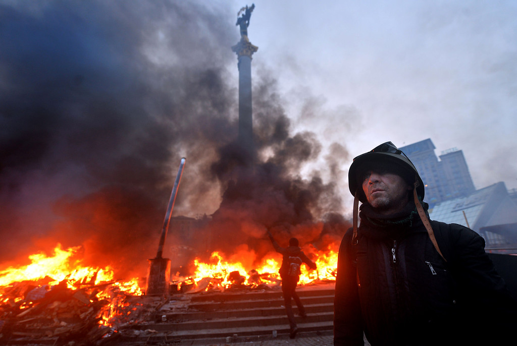 . An anti-government protester wearing a helmet stands on Independence Square in Kiev during clashes with the police early on February 19, 2014.  AFP PHOTO/SERGEI  SUPINSKY/AFP/Getty Images