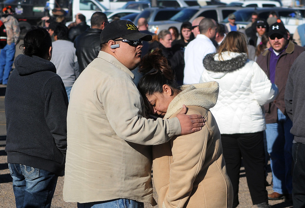 . Families wait for news at a staging ground area set up at the Roswell Mall following a shooting at Berrendo Middle School, Tuesday, Jan. 14, 2014, in Roswell, N.M. A shooter opened fire at the middle school, injuring at least two students before being taken into custody. Roswell police said the school was placed on lockdown, and the suspected shooter was arrested. (AP Photo/Roswell Daily Record, Mark Wilson)