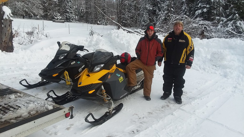 A couple of guys and their snow machines on the Sno-Birds Trails