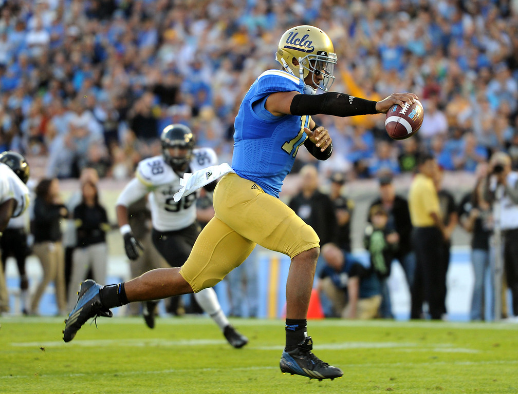 . UCLA QB Brett Hundley runs in for an 11-yard touchdown in the second quarter against Colorado, Saturday, November 2, 2013, at the Rose Bowl. (Photo by Michael Owen Baker/L.A. Daily News)