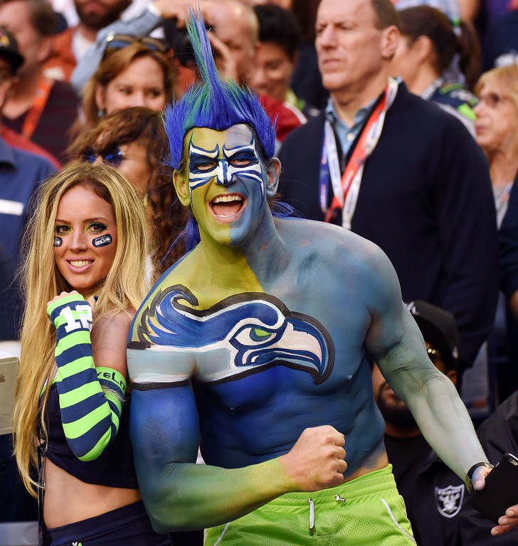 . Fans of the Seattle Seahawks cheer before Super Bowl XLIX against the New England Patriots on February 1, 2015 at the at University of Phoenix Stadium in Glendale, Arizona. TIMOTHY A. CLARY/AFP/Getty Images