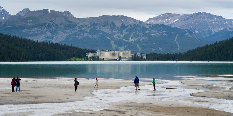 Tourists at lakeside with Fairmont Chateau in the background, Lake Louise, Improvement District 9, Banff National Park, Jasper, Alberta, Canada