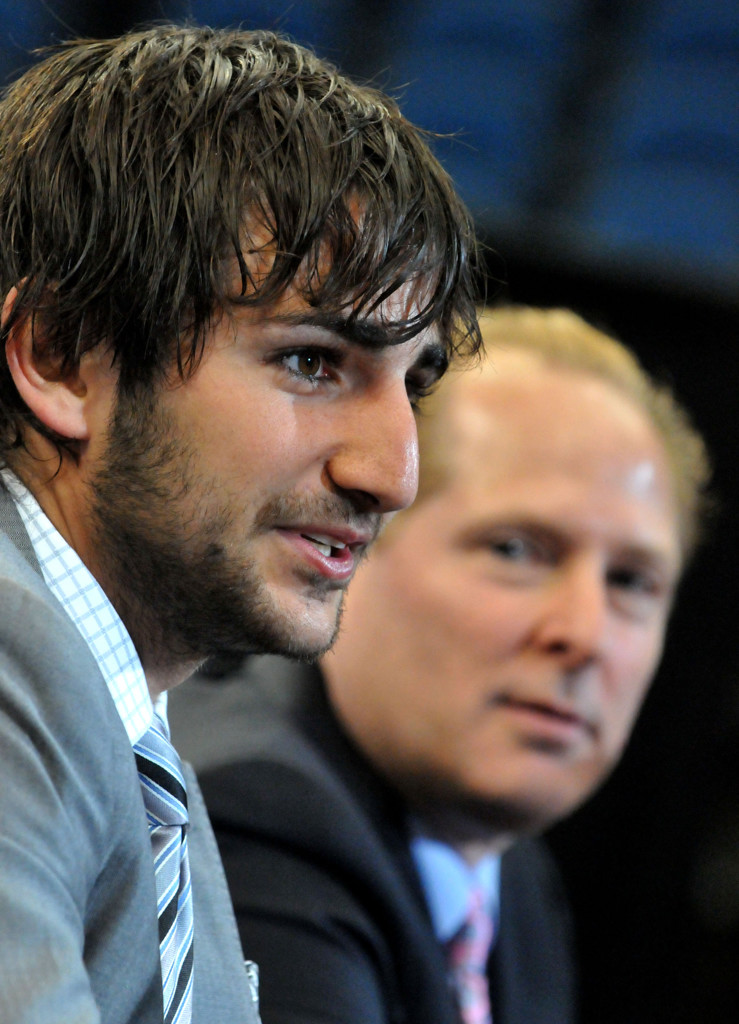 . David Kahn, right, listens as his new point guard, Ricky Rubio, answers questions during a press conference at Target Center in Minneapolis on Tuesday June 21, 2011.  (Pioneer Press: John Doman)