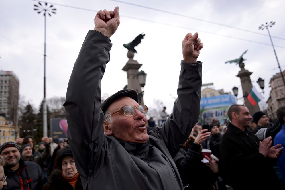 . A man shouts slogans as people block the traffic during a protest against high electricity bills in Sofia February 17, 2013. Tens of thousands of Bulgarians protested in more than 20 cities against high electricity bills on Sunday, piling pressure on the government after a week of persistent demonstrations.  REUTERS/Tsvetelina Belutova