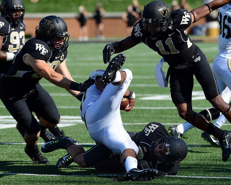 Ryan Janvion tackles T Baggett.jpg