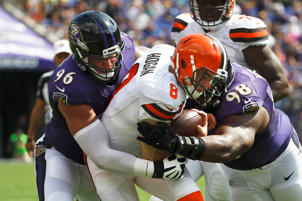 . Cleveland Browns quarterback Kevin Hogan (8) is sandwiched between Baltimore Ravens defensive end Brent Urban (96) and Baltimore Ravens nose tackle Brandon Williams (98) during the first half of an NFL football game in Baltimore, Sunday, Sept. 17, 2017. (AP Photo/Patrick Semansky)