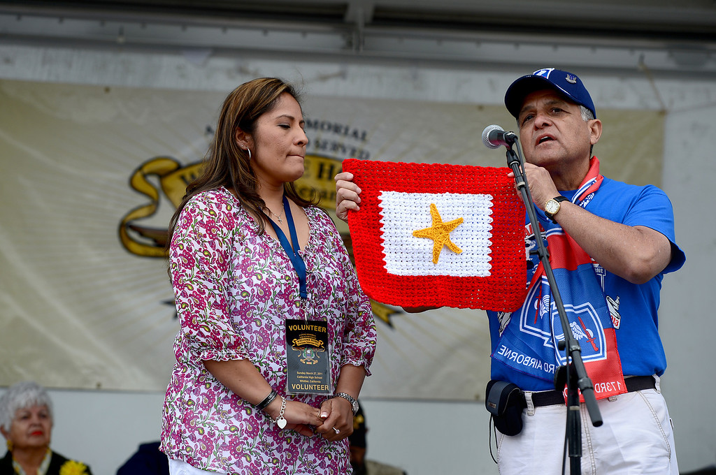 . During her keynote speech, Army Veteran Cindy Rowe is presented a Gold Star during Jose Ramos\' annual Welcome Home Vietnam Veterans Day at California High School in Whittier Saturday, April 13, 2013.  (SGVN/Staff Photo by Sarah Reingewirtz)