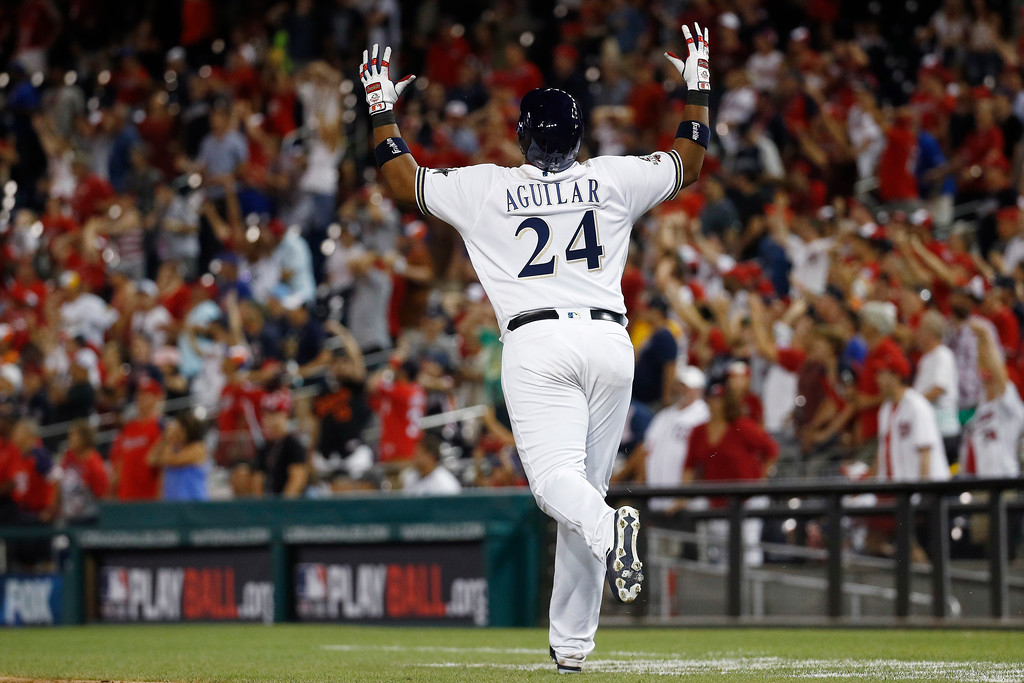 . Milwaukee Brewers first baseman Jesus Aguilar (24) reacts to flying out in the ninth inning during the Major League Baseball All-star Game, Tuesday, July 17, 2018 in Washington. (AP Photo/Patrick Semansky)