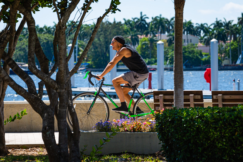 A man rides his bike along the waterfront in downtown West Palm Beach, Friday, May 1, 2020. [JOSEPH FORZANO/palmbeachpost.com]