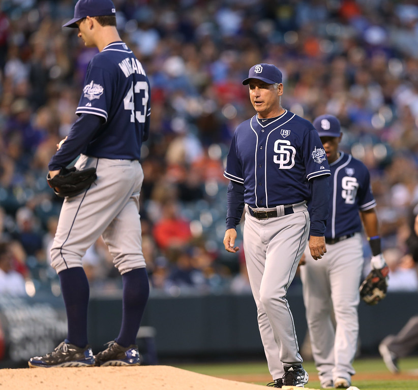 . San Diego Padres manager Bud Black, right, approaches the mound to remove starting pitcher Joe Wieland after he gave up a double to Colorado Rockies\' Josh Rutledge in the third inning of a baseball game in Denver on Saturday, Sept. 6, 2014. (AP Photo/David Zalubowski)