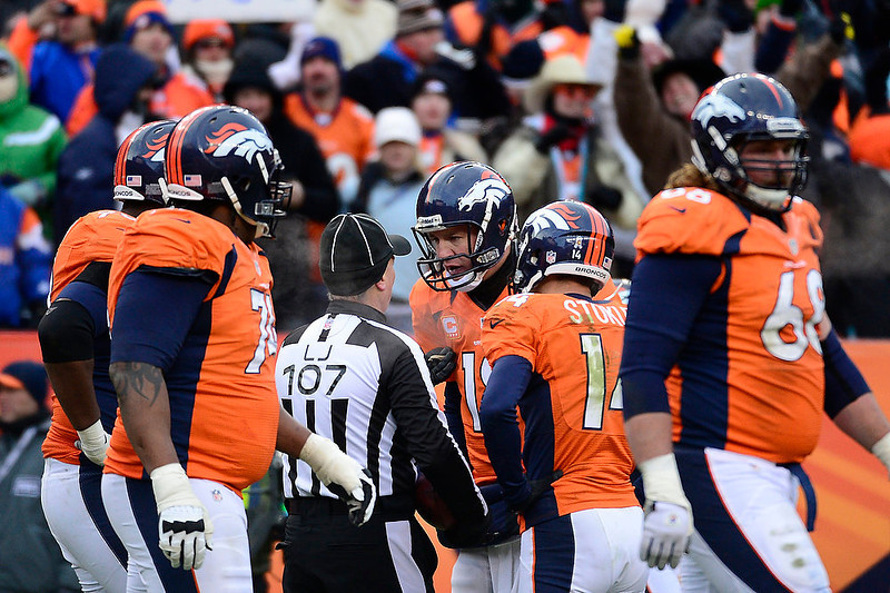 . Denver Broncos quarterback Peyton Manning (18) talks with the referee in the second quarter. The Denver Broncos vs Baltimore Ravens AFC Divisional playoff game at Sports Authority Field Saturday January 12, 2013. (Photo by AAron  Ontiveroz,/The Denver Post)