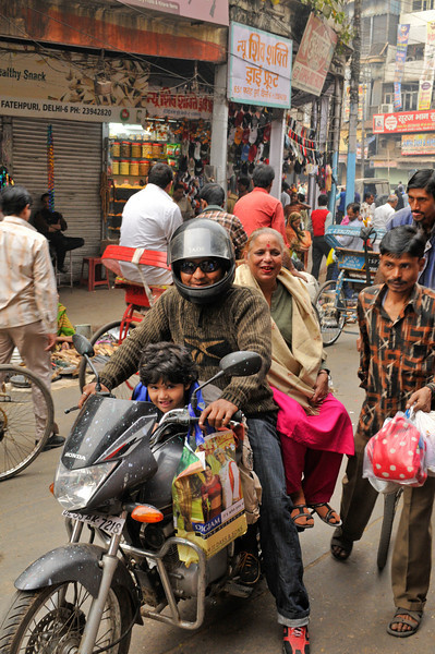 It is not unusual to see families of 3 or 4 on a motorcycle.