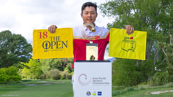 Yuxin Lim from China celebrating his direct entry into the Masters and the Open with their flags  immediately after winning the Asia-Pacific Amateur Championship tournament 2017 held at Royal Wellington Golf Club, in Heretaunga, Upper Hutt, New Zealand from 26 - 29 October 2017. Copyright John Mathews 2017.   www.megasportmedia.co.nz