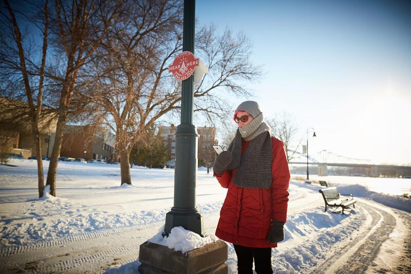 Buildings; Downtown; Location; Outside; Objects; Phone Cell Smartphone iPhone; People; Professor; Time/Weather; snowy; Type of Photography; Candid; UWL UW-L UW-La Crosse University of Wisconsin-La Crosse; Winter; December; Ariel Beaujot Hear Here Downtown Riverside Park